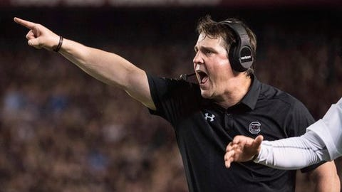 South Carolina head coach Will Muschamp communicates with players during the first half of an NCAA college football game against Kentucky, Saturday, Sept. 16, 2017, in Columbia, S.C. (AP Photo/Sean Rayford)