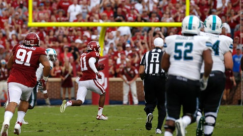 Oklahoma cornerback Parnell Motley (11) returns a interception for a touchdown against Tulane during an NCAA college football game in Norman, Okla., Saturday, Sept. 16, 2017. (AP Photo/Mitch Alcala)