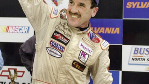 FILE - In this Sept. 16, 2005 file photo, Ted Christopher celebrates his victory in the Busch North Series Sylvania 125 at the New Hampshire International Speedway in Loudon, N.H. NASCAR officials say modified championship racer Christopher was one of two people killed when a small plane crashed in Connecticut. The Federal Aviation Administration confirms that two people were aboard a Mooney M20C plane that went down in a wooded area near the North Branford-Guilford border shortly before 2 p.m. Saturday, Sept. 16, 2017. NASCAR says Christopher and the plane's pilot died. (AP Photo/Jon-Pierre Lasseigne, File)