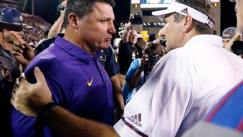 Mississippi State head football coach Dan Mullen confers with LSU head football coach Ed Orgeron following their NCAA college football game against in Starkville, Miss., Saturday, Sept. 16, 2017. Mississippi State won 37-7. (AP Photo/Rogelio V. Solis)