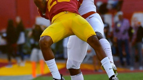 Southern California cornerback Jack Jones, left, intercepts a pass that was intended for Texas wide receiver Devin Duvernay during the first half of an NCAA college football game, Saturday, Sept. 16, 2017, in Los Angeles. (AP Photo/Mark J. Terrill)