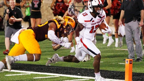 Texas Tech's Cameron Batson scores a first-half touchdown while chased by Arizona State's Dasmond Tautalatasi during the first half of an NCAA college football game Saturday, Sept. 16, 2017, in Lubbock, Texas. (Mark Rogers/Lubbock Avalanche-Journal via AP)