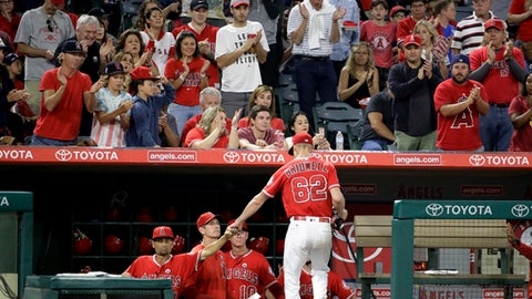 Los Angeles Angels starting pitcher Parker Bridwell is greeted at the dugout after leaving the baseball game against the Texas Rangers during the seventh inning in Anaheim, Calif., Saturday, Sept. 16, 2017. (AP Photo/Chris Carlson)
