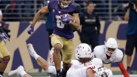 Washington's Dante Pettis (8) leaves several Fresno State defenders in his wake on his punt return for a touchdown in the first half of an NCAA college football game Saturday, Sept. 16, 2017, in Seattle. Pettis tied the NCAA career record for punt return touchdowns on the 77-yard return, the eighth of his career. (AP Photo/Elaine Thompson)