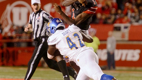 Utah quarterback Tyler Huntley (1) is hit by San Jose State linebacker Jamal Scott (42) after throwing the ball out of bounds during an NCAA college football game Saturday, Sept. 16, 2017, in Salt Lake City. (Trent Nelson/The Salt Lake Tribune via AP)