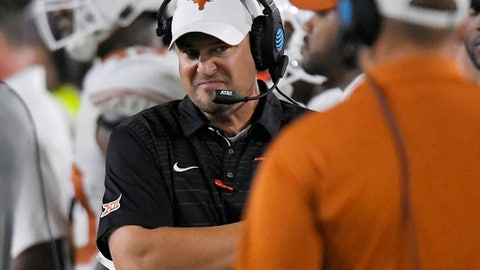 Texas coach Tom Herman stands on the sideline during the second half of the team's NCAA college football game against Southern California, Saturday, Sept. 16, 2017, in Los Angeles. USC won 27-24 in overtime. (AP Photo/Mark J. Terrill)