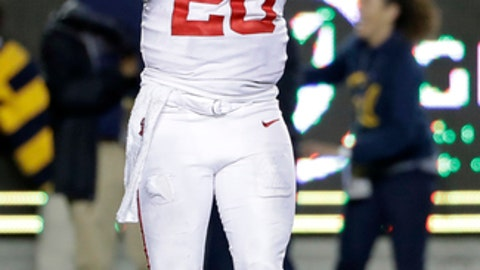 Mississippi quarterback Shea Patterson holds his helmet after throwing an interception which was returned for a touchdown during the second half of an NCAA college football game Saturday, Sept. 16, 2017, in Berkeley, Calif. (AP Photo/Marcio Jose Sanchez)