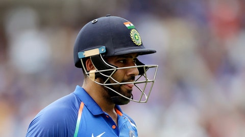 Indian cricket player Rohit Sharma on his way to pavilion after got out during the first one-day international cricket match between India and Australia in Chennai, India, Sunday, Sept. 17, 2017. (AP Photo/Rajanish Kakade)