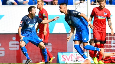 Hoffenheim's scorer Sandro Wagner, front right, and his teammate Havard Nordtveit, front left, celebrate the opening goal during the German Bundesliga soccer match between 1899 Hoffenheim and Hertha BSC Berlin in Sinsheim, Germany, Sunday, Sept. 17, 2017. (Uwe Anspach/dpa via AP)