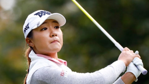 Lydia Ko, of New Zealand, plays a shot on the 4th hole during the final round of the Evian Championship women's golf tournament in Evian, eastern France, Sunday, Sept. 17, 2017. (AP Photo/Laurent Cipriani)