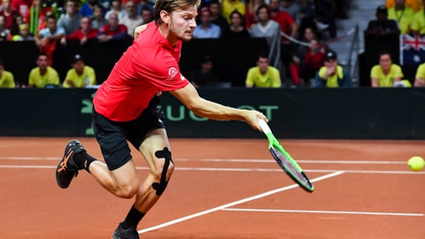 Belgium's David Goffin returns the ball to Australia's Nick Kyrgios during a Davis Cup World Group semi-final tennis match in Brussels, Sunday, Sept. 17, 2017. (AP Photo/Geert Vanden Wijngaert)
