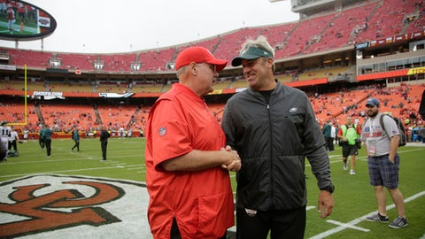 Kansas City Chiefs head coach Andy Reid, left, chats with Philadelphia Eagles head coach Doug Pederson before an NFL football game in Kansas City, Mo., Sunday, Sept. 17, 2017. (AP Photo/Charlie Riedel)