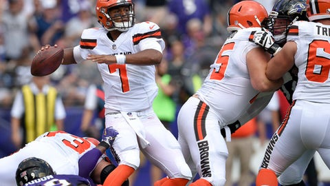 Cleveland Browns quarterback DeShone Kizer (7) passes the ball under pressure during the first half of an NFL football game against the Baltimore Ravens in Baltimore, Sunday, Sept. 17, 2017. (AP Photo/Nick Wass)