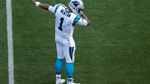 Carolina Panthers' Cam Newton (1) gestures after running for a first down against the Buffalo Bills in the first half of an NFL football game in Charlotte, N.C., Sunday, Sept. 17, 2017. (AP Photo/Jason E. Miczek)