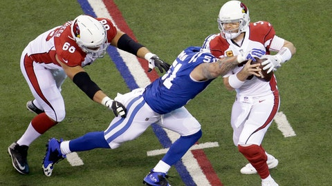 Arizona Cardinals quarterback Carson Palmer (3) is sacked by Indianapolis Colts' John Simon (51) during the first half of an NFL football game Sunday, Sept. 17, 2017, in Indianapolis. (AP Photo/AJ Mast)