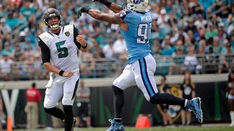 Tennessee Titans outside linebacker Derrick Morgan, right, knocks down a pass thrown by Jacksonville Jaguars quarterback Blake Bortles (5) during the first half of an NFL football game, Sunday, Sept. 17, 2017, in Jacksonville, Fla. (AP Photo/Phelan M. Ebenhack)