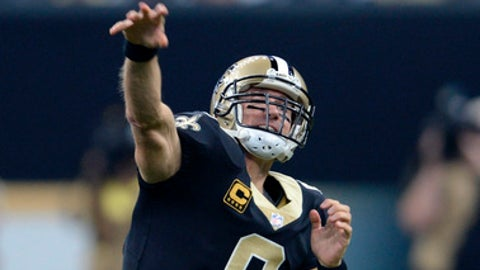 New Orleans Saints quarterback Drew Brees (9) passes in the first half of an NFL football game against the New England Patriots in New Orleans, Sunday, Sept. 17, 2017. (AP Photo/Butch Dill)