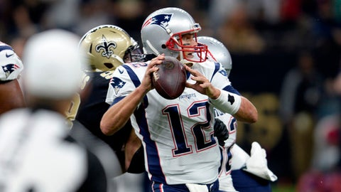 New England Patriots quarterback Tom Brady (12) passes under pressure in the first half of an NFL football game against the New Orleans Saints in New Orleans, Sunday, Sept. 17, 2017. (AP Photo/Bill Feig)