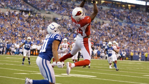 Arizona Cardinals' J.J. Nelson (14) makes a catch against Indianapolis Colts' Quincy Wilson during the first half of an NFL football game Sunday, Sept. 17, 2017, in Indianapolis. (AP Photo/Michael Conroy)