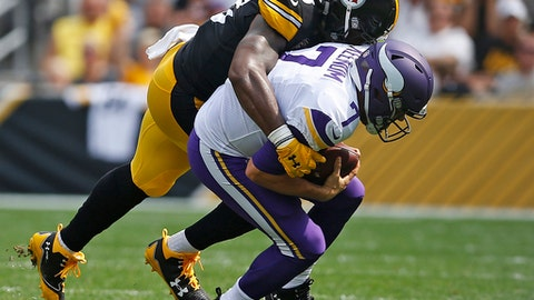 Minnesota Vikings quarterback Case Keenum (7) is sacked by Pittsburgh Steelers outside linebacker Bud Dupree (48) during the first half of an NFL football game in Pittsburgh, Sunday, Sept. 17, 2017. (AP Photo/Keith Srakocic)