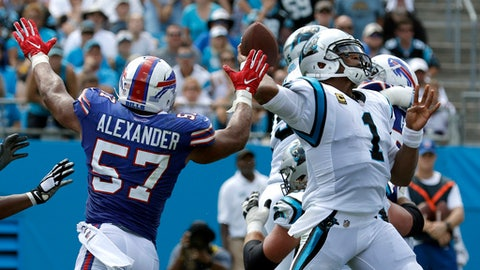 Carolina Panthers' Cam Newton (1) looks to pass under pressure from Buffalo Bills' Lorenzo Alexander (57) in the first half of an NFL football game in Charlotte, N.C., Sunday, Sept. 17, 2017. (AP Photo/Bob Leverone)