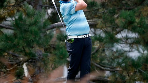 Marc Leishman lets go of his club after making his tee shot on the fourth hole during the final round of the BMW Championship golf tournament at Conway Farms Golf Club, Sunday, Sept. 17, 2017, in Lake Forest, Ill. (AP Photo/Charles Rex Arbogast)