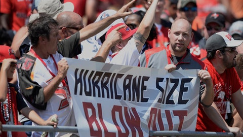 Fans cheer as the Tampa Bay Buccaneers lead the Chicago Bears at the end of the first half of an NFL football game, Sunday, Sept. 17, 2017, in Tampa, Fla. (AP Photo/Jason Behnken)