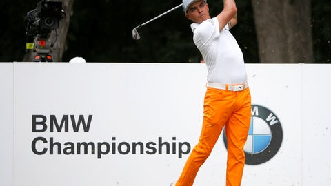 Rickie Fowler watches his tee shot on the second hole during the final round of the BMW Championship golf tournament at Conway Farms Golf Club, Sunday, Sept. 17, 2017, in Lake Forest, Ill. (AP Photo/Charles Rex Arbogast)