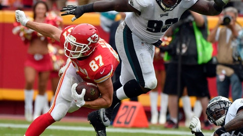 Philadelphia Eagles defensive tackle Tim Jernigan (93) goes airborne while tackling Kansas City Chiefs tight end Travis Kelce (87) during the second half of an NFL football game in Kansas City, Mo., Sunday, Sept. 17, 2017. (AP Photo/Ed Zurga)