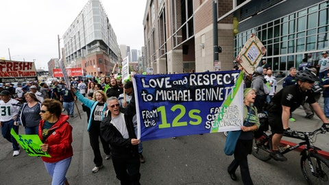Demonstrators show support for Seattle Seahawks defensive end Michael Bennett as they march outside CenturyLink Field before an NFL football game between the Seahawks and the San Francisco 49ers, Sunday, Sept. 17, 2017, in Seattle. Bennett has been a vocal supporter of Black Lives Matter and other social issues. (AP Photo/John Froschauer)