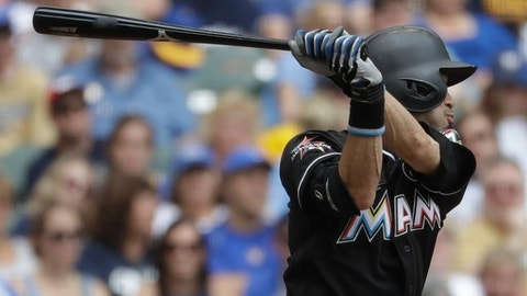Miami Marlins' Ichiro Suzuki hits a two-run scoring double during the fourth inning of a baseball game against the Milwaukee Brewers Sunday, Sept. 17, 2017, in Milwaukee. (AP Photo/Morry Gash)