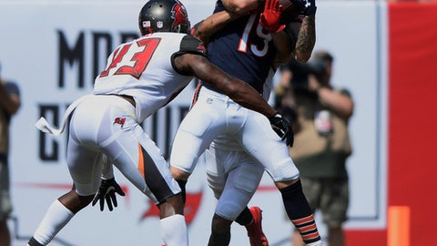 Chicago Bears wide receiver Tanner Gentry (19) grabs a pass ahead of a tackle by Tampa Bay Buccaneers defensive back T.J. Ward (43), during the second half of an NFL football game, Sunday, Sept. 17, 2017, in Tampa, Fla. The Bucs defeated the Bears 29-7. (AP Photo/Jason Behnken)