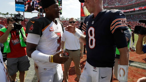 Tampa Bay Buccaneers quarterback Jameis Winston (3) and Chicago Bears quarterback Mike Glennon (8) talk at the end of an NFL football game, Sunday, Sept. 17, 2017, in Tampa, Fla. The Bucs defeated the Bears 29-7. (AP Photo/Chris O'Meara)