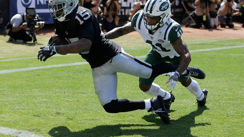 Oakland Raiders wide receiver Michael Crabtree (15) catches a touchdown pass against New York Jets defensive back Buster Skrine (41) during the first half of an NFL football game in Oakland, Calif., Sunday, Sept. 17, 2017. (AP Photo/Ben Margot)