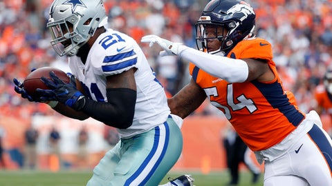 Dallas Cowboys running back Ezekiel Elliott (21) makes a catch as Denver Broncos inside linebacker Brandon Marshall (54) defends during the first half of an NFL football game, Sunday, Sept. 17, 2017, in Denver. (AP Photo/Jack Dempsey)