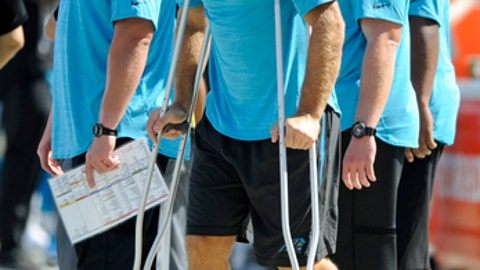 Carolina Panthers' Greg Olsen stands on crutches in the second half of an NFL football game against the Buffalo Bills in Charlotte, N.C., Sunday, Sept. 17, 2017. Olsen was injured earlier in the game. (AP Photo/Mike McCarn)