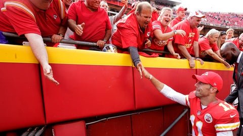 Kansas City Chiefs quarterback Alex Smith (11) celebrates with fans after an NFL football game against the Philadelphia Eagles, Sunday, Sept. 17, 2017, in Kansas City, Mo. (AP Photo/Charlie Riedel)