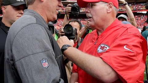 Philadelphia Eagles head coach Doug Pederson, left, talks to Kansas City Chiefs head coach Andy Reid after an NFL football game Sunday, Sept. 17, 2017, in Kansas City, Mo. (AP Photo/Charlie Riedel)