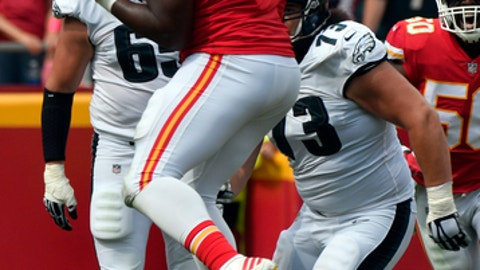 Kansas City Chiefs defensive lineman Chris Jones (95) catches a deflected pass from Philadelphia Eagles quarterback Carson Wentz for a turnover in front of wide receiver Nelson Agholor (13) and offensive tackle Lane Johnson (65), during the second half of an NFL football game in Kansas City, Mo., Sunday, Sept. 17, 2017. (AP Photo/Ed Zurga)