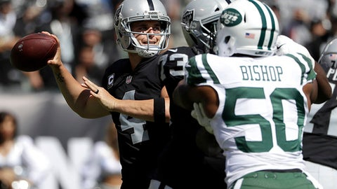 Oakland Raiders quarterback Derek Carr (4) passes as New York Jets linebacker Freddie Bishop (50) applies pressure during the first half of an NFL football game in Oakland, Calif., Sunday, Sept. 17, 2017. (AP Photo/Marcio Jose Sanchez)