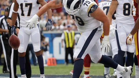 Los Angeles Rams offensive tackle Rob Havenstein celebrates after a touchdown by running back Todd Gurley during the first half of an NFL football game against the Washington Redskins Sunday, Sept. 17, 2017, in Los Angeles. (AP Photo/Jae C. Hong)