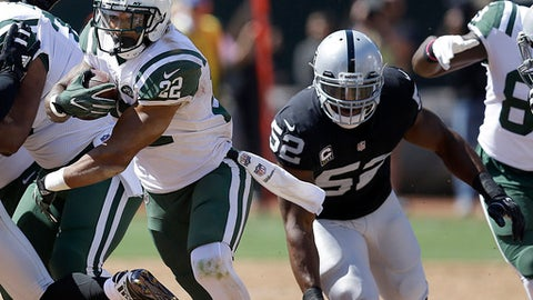 New York Jets running back Matt Forte (22) runs in front of Oakland Raiders defensive end Khalil Mack (52) during the first half of an NFL football game in Oakland, Calif., Sunday, Sept. 17, 2017. (AP Photo/Ben Margot)