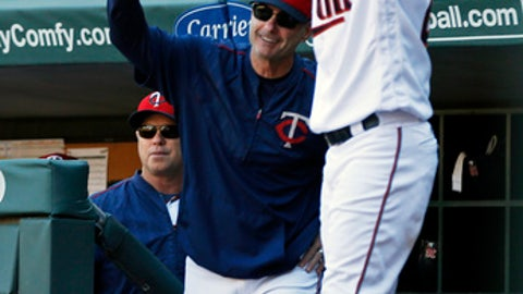 Minnesota Twins manager Paul Molitor, center left, celebrates Joe Mauer's grand slam off Toronto Blue Jays relief pitcher Chris Rowley in the fifth inning of a baseball game Sunday, Sept. 17, 2017, in Minneapolis. (AP Photo/Jim Mone)