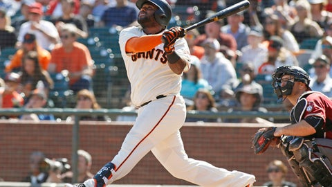 San Francisco Giants' Pablo Sandoval hits a home run against the Arizona Diamondbacks during the sixth inning of a baseball game, Sunday, Sept. 17, 2017, in San Francisco. Diamondbacks catcher Chris Iannetta, right, looks on. (AP Photo/George Nikitin)