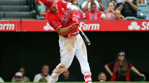 Los Angeles Angels' Mike Trout connects on a long RBI fly ball against the Texas Rangers in the fifth inning of a baseball game in Anaheim, Calif., Sunday, Sept. 17, 2017. (AP Photo/Reed Saxon)