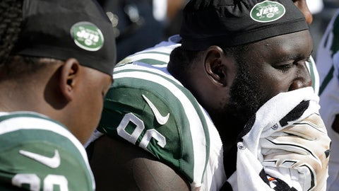 New York Jets defensive end Muhammad Wilkerson, right, sits on the bench during the second half of an NFL football game against the Oakland Raiders in Oakland, Calif., Sunday, Sept. 17, 2017. (AP Photo/Ben Margot)