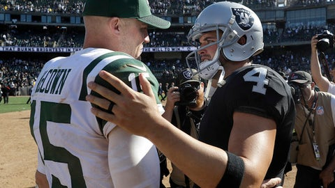 New York Jets quarterback Josh McCown, left, greets Oakland Raiders quarterback Derek Carr after an NFL football game in Oakland, Calif., Sunday, Sept. 17, 2017. (AP Photo/Marcio Jose Sanchez)