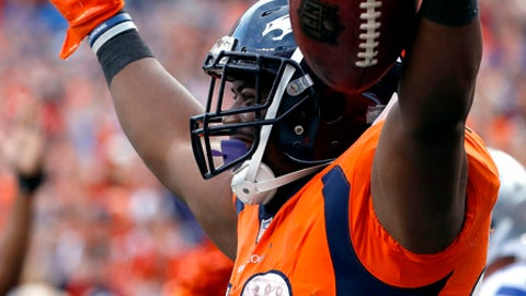 Denver Broncos running back C.J. Anderson (22) celebrates his touchdown against the Dallas Cowboys during the second half of an NFL football game, Sunday, Sept. 17, 2017, in Denver. (AP Photo/Jack Dempsey)