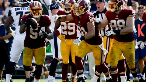 Washington Redskins inside linebacker Mason Foster, left, celebrates after intercepting a pass during the second half of an NFL football game against the Los Angeles Rams Sunday, Sept. 17, 2017, in Los Angeles. (AP Photo/Jae C. Hong)