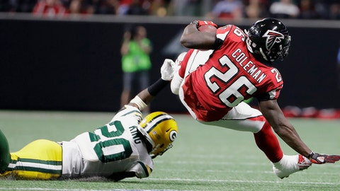 Atlanta Falcons running back Tevin Coleman (26) is tackled by Green Bay Packers cornerback Kevin King (20) during the second of an NFL football game, Sunday, Sept. 17, 2017, in Atlanta. (AP Photo/David Goldman)